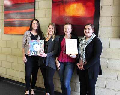 The two winning designs with students (l-r) Tahlia Allen, Sandy Jurewicz, Toni Northall and Alison Collier