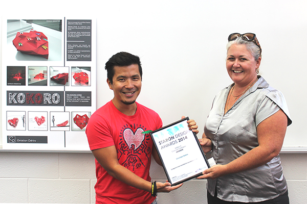 Christian receives award from Fiona Parsons - Specifications Manager, Austaron Surfaces
