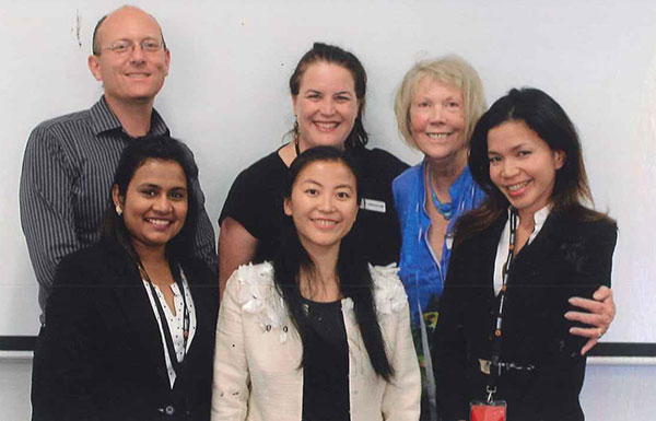 Anne with colleagues and three Central ESL students
